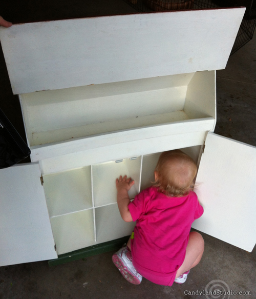 Little Baby checking out the dollhouse